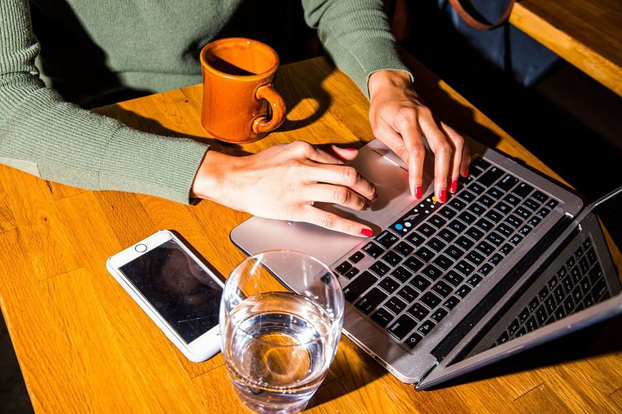someone-working-from-home-computer-smartphone-on-table